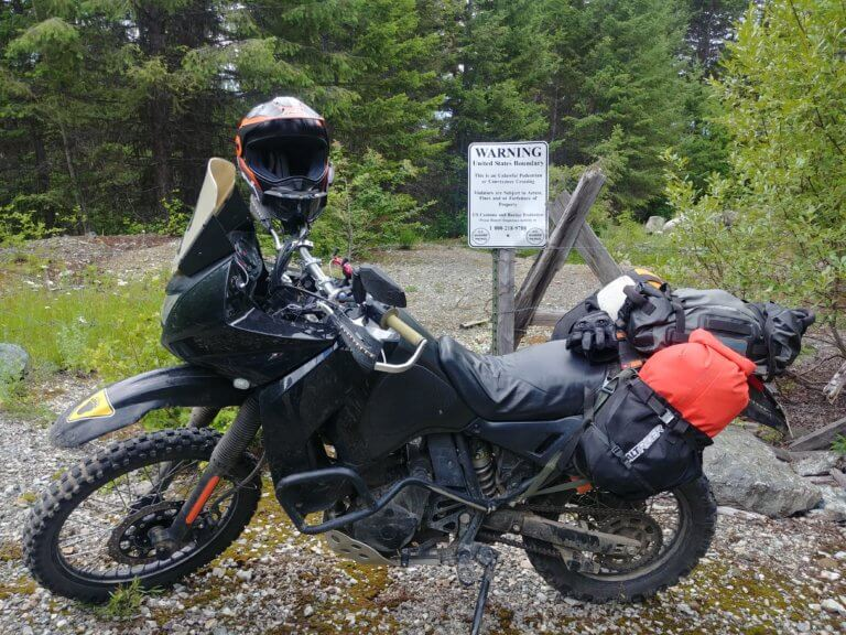 motorcycle in front of border sign