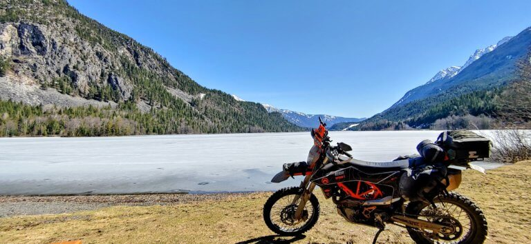 a picture of a frozen summit lake with motorcycle