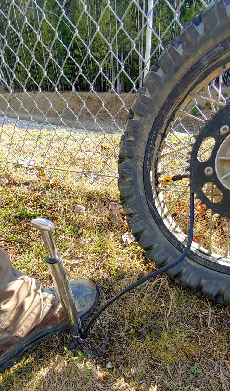 pumping up a motorcycle tire