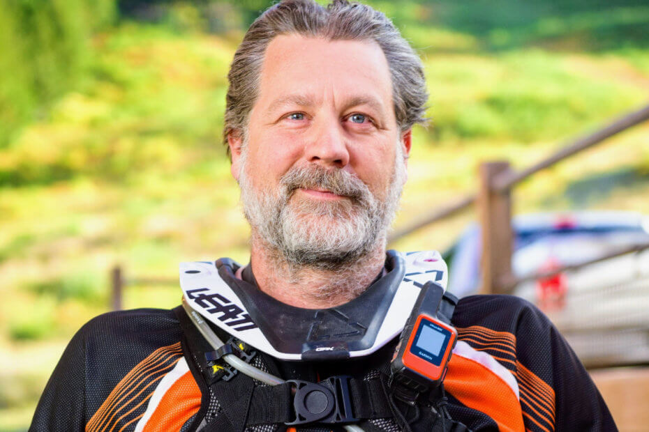 motorcycle rider with neck brace and Garmin inreach