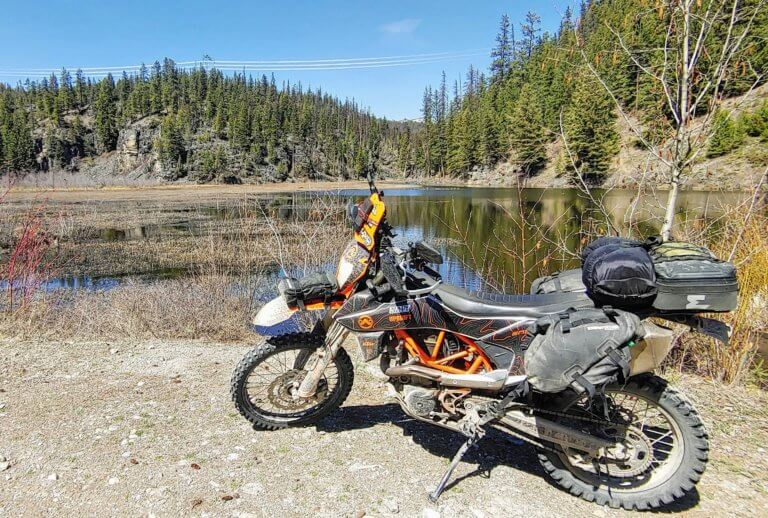 dual sport KTM motorcycle in front of a lake